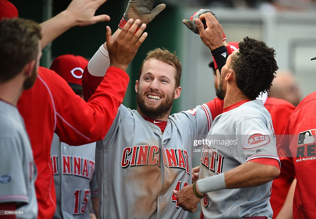 Tyler Holt #40 of the Cincinnati Reds celebrates with teammates after scoring during the eighth inning against the Pittsburgh Pirates on May 1, 2016 at PNC Park in Pittsburgh, Pennsylvania.