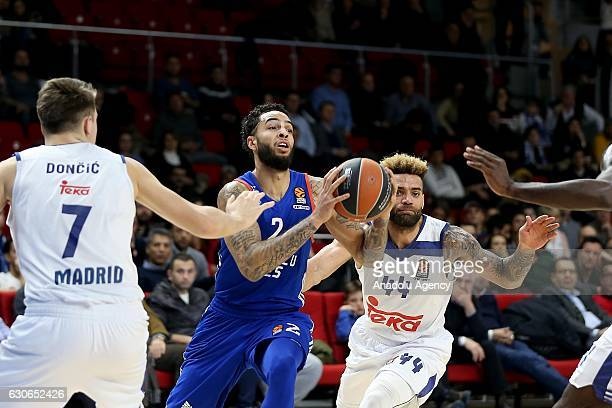 Tyler Honeycutt of Anadolu Efes Istanbul is in action against Luka Doncic and Jeffery Taylor of Real Madrid during the Turkish Airlines Euroleague...