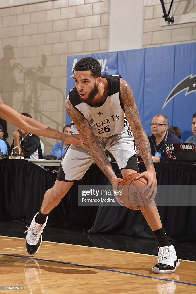 Tyler Honeycutt #26 of the Houston Rockets protects the ball during the 2013 Southwest Airlines Orlando Pro Summer League game between the Oklahoma City Thunder and the Houston Rockets on July 12, 2013 at Amway Center in Orlando, Florida.