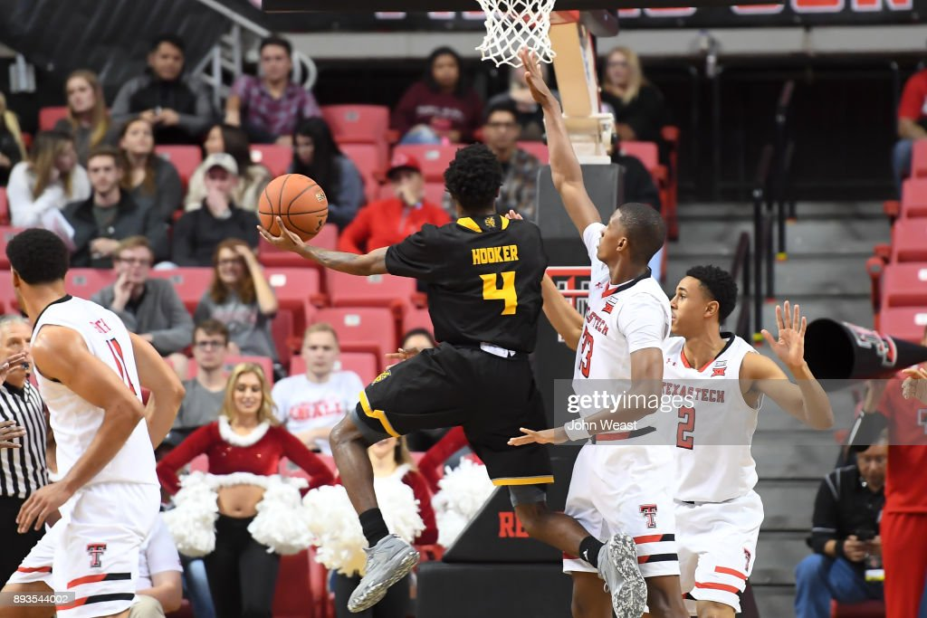 Tyler Hooker #4 of the Kennesaw State Owls goes to the basket during the game against the Texas Tech Red Raiders on December 13, 2017 at United Supermarkets Arena in Lubbock, Texas. Texas Tech defeated Kennesaw State 82-53.