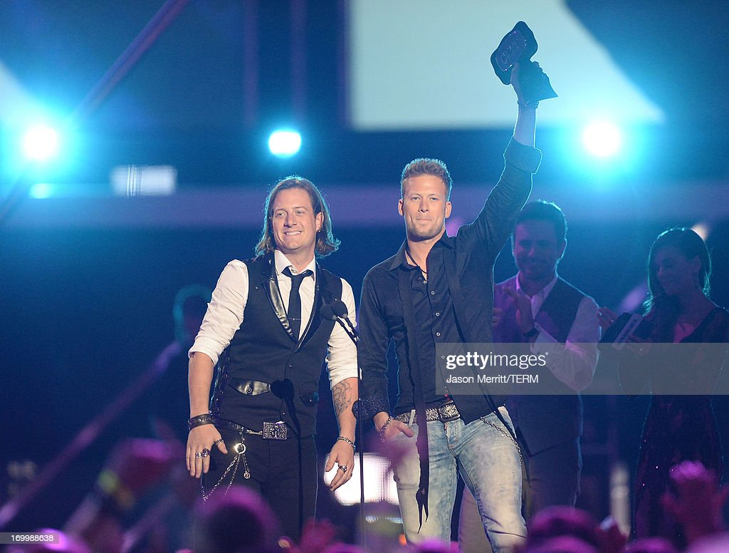 <a gi-track='captionPersonalityLinkClicked' href=/galleries/search?phrase=Tyler+Hubbard&family=editorial&specificpeople=9453787 ng-click='$event.stopPropagation()'>Tyler Hubbard</a> and Brian Kelley of Florida Georgia Line accept an award onstage during the 2013 CMT Music awards at the Bridgestone Arena on June 5, 2013 in Nashville, Tennessee.