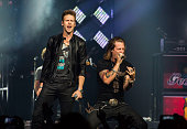 Tyler Hubbard and Brian Kelley of Florida Georgia Line perform at The Palace of Auburn Hills on October 10 2014 in Auburn Hills Michigan