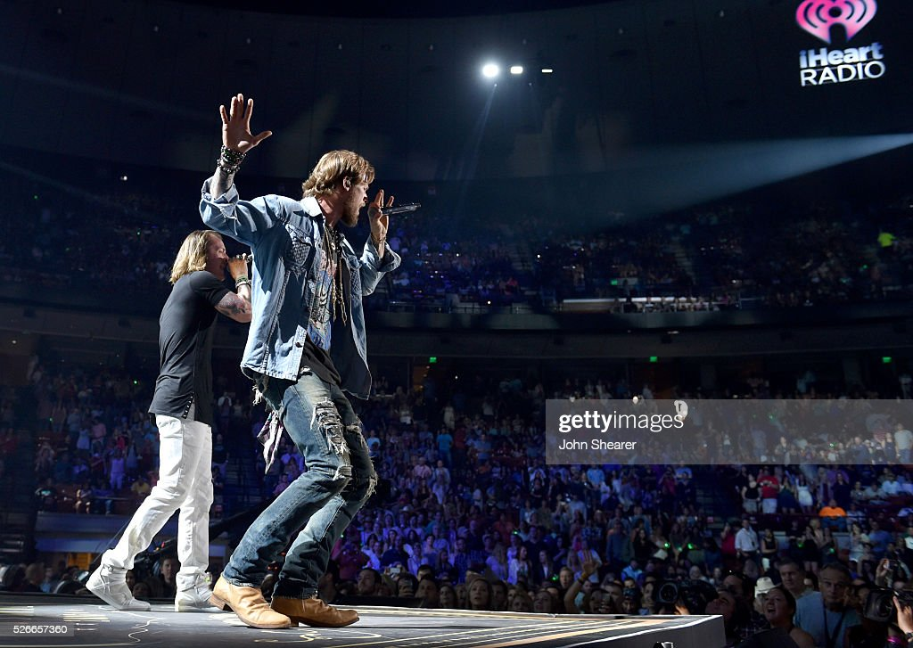Tyler Hubbard (L) and Brian Kelley (R) of Florida Georgia Line perform onstage during the 2016 iHeartCountry Festival at The Frank Erwin Center on April 30, 2016 in Austin, Texas.