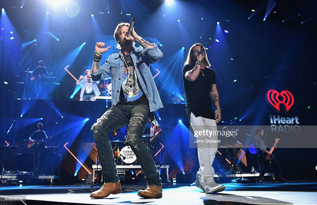 Tyler Hubbard (R) and Brian Kelley (L) of Florida Georgia Line perform onstage during the 2016 iHeartCountry Festival at The Frank Erwin Center on April 30, 2016 in Austin, Texas.