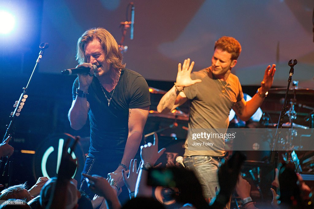Tyler Hubbard and Brian Kelley of Florida Georgia Line performs at Brick Street Bar on February 20, 2013 in Oxford, Ohio.