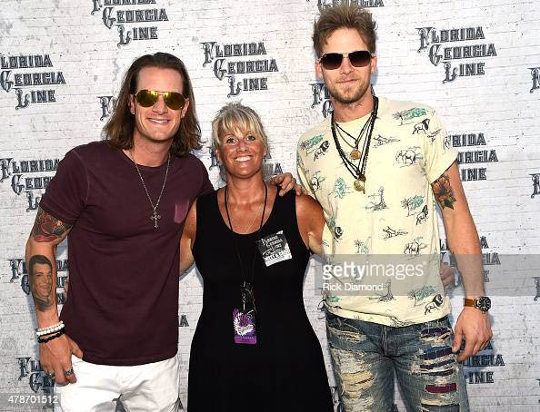Tyler Hubbard and Brian Kelley of Florida Georiga Line with Jill Kopecky Neste Event Marketing backstage during Kicker Country Stampede Day 2 on June...