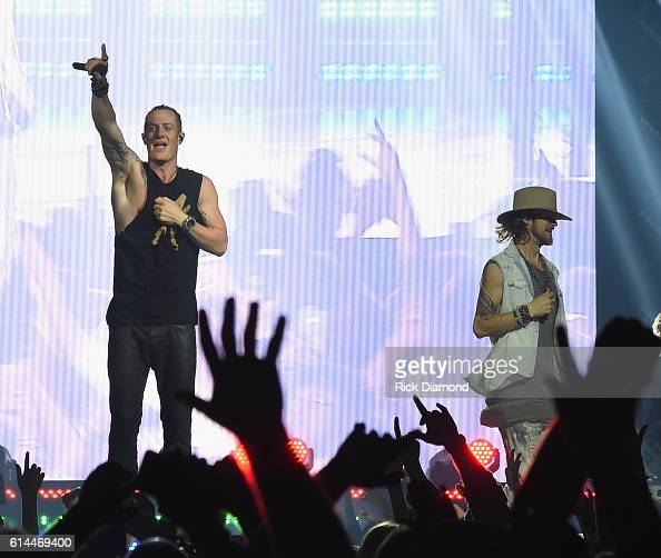 Tyler Hubbard and Brian Kelly of Florida Georgia Line perform during their Dig Your Roots 2016 Tour at Bridgestone Arena on October 13 2016 in...