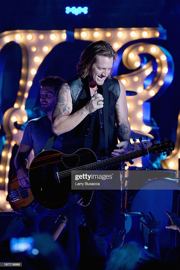 Tyler Hubbard of Florida Georgia Line performs onstage during the 47th annual CMA awards at the Bridgestone Arena on November 6, 2013 in Nashville, United States.