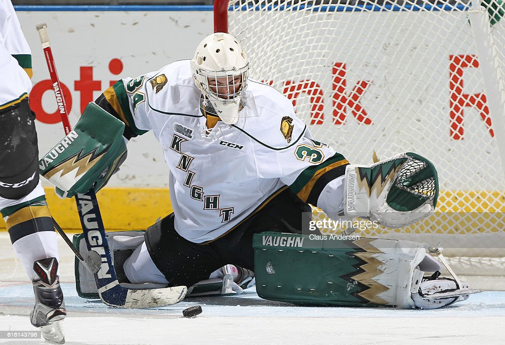Tyler Johnson #34 of the London Knights makes a save against the Saginaw Spirit during an OHL game at Budweiser Gardens on October 21, 2016 in London, Ontario, Canada. The Knights defeated the Spirit 5-1.