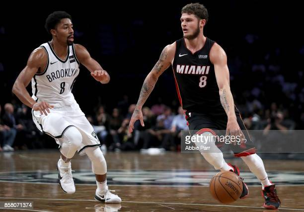 Tyler Johnson of the Miami Heat drives to the basket against Spencer Dinwiddie of the Brooklyn Nets in the first half during their Pre Season game at...