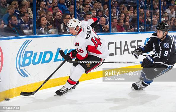 Tyler Johnson of the Tampa Bay Lightning battles for the puck against Patrick Wiercioch of the Ottawa Senators during the first period at the Amalie...