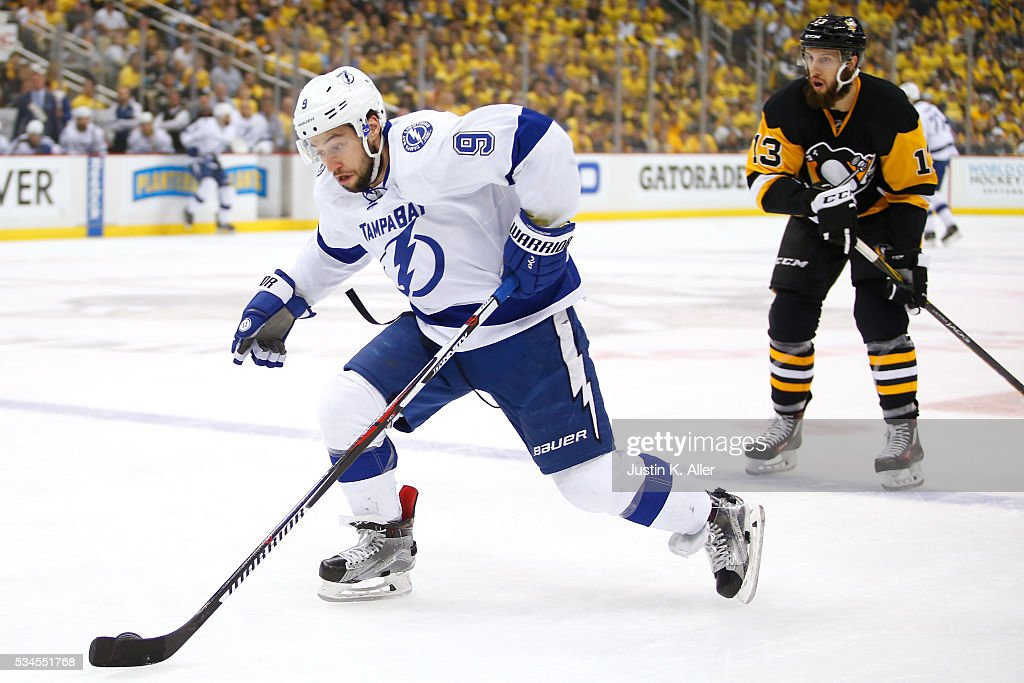 <a gi-track='captionPersonalityLinkClicked' href=/galleries/search?phrase=Tyler+Johnson+-+Ice+Hockey+Player&family=editorial&specificpeople=14574766 ng-click='$event.stopPropagation()'>Tyler Johnson</a> #9 of the Tampa Bay Lightning breaks away with the puck against <a gi-track='captionPersonalityLinkClicked' href=/galleries/search?phrase=Nick+Bonino&family=editorial&specificpeople=5805660 ng-click='$event.stopPropagation()'>Nick Bonino</a> #13 of the Pittsburgh Penguins during the first period in Game Seven of the Eastern Conference Final during the 2016 NHL Stanley Cup Playoffs at Consol Energy Center on May 26, 2016 in Pittsburgh, Pennsylvania.