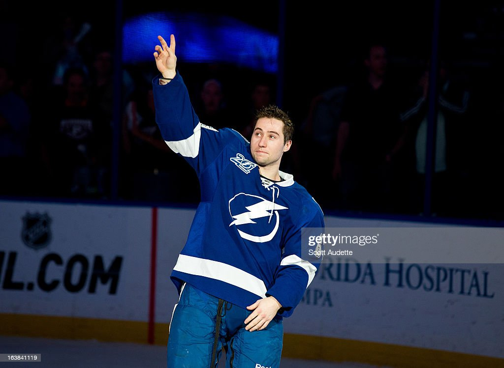 <a gi-track='captionPersonalityLinkClicked' href=/galleries/search?phrase=Tyler+Johnson+-+Ice+Hockey+Player&family=editorial&specificpeople=14574766 ng-click='$event.stopPropagation()'>Tyler Johnson</a> #63 of the Tampa Bay Lightning celebrates after the Tampa Bay Lightning defeat the Carolina Hurricanes 4-1 at the Tampa Bay Times Forum on March 16, 2013 in Tampa, Florida.