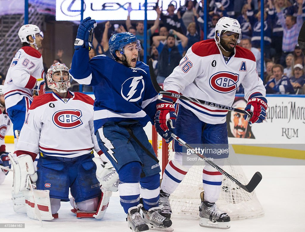Tyler Johnson of the Tampa Bay Lightning celebrates his game winning goal against goalie Carey Price and PK Subban of the Montreal Canadiens during...