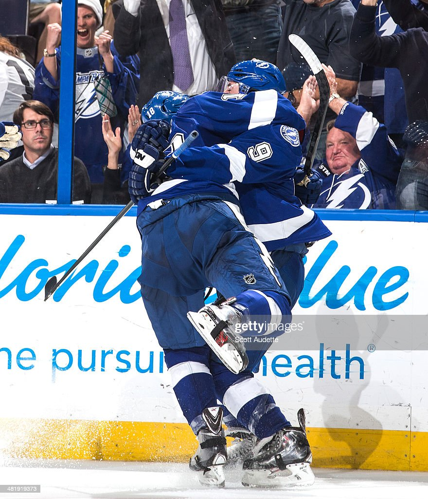 <a gi-track='captionPersonalityLinkClicked' href=/galleries/search?phrase=Tyler+Johnson+-+Ice+Hockey+Player&family=editorial&specificpeople=14574766 ng-click='$event.stopPropagation()'>Tyler Johnson</a> #9 of the Tampa Bay Lightning celebrates his goal with teammate Ondrej Palat #18 against the Montreal Canadiens during the third period at the Tampa Bay Times Forum on April 1, 2014 in Tampa, Florida.