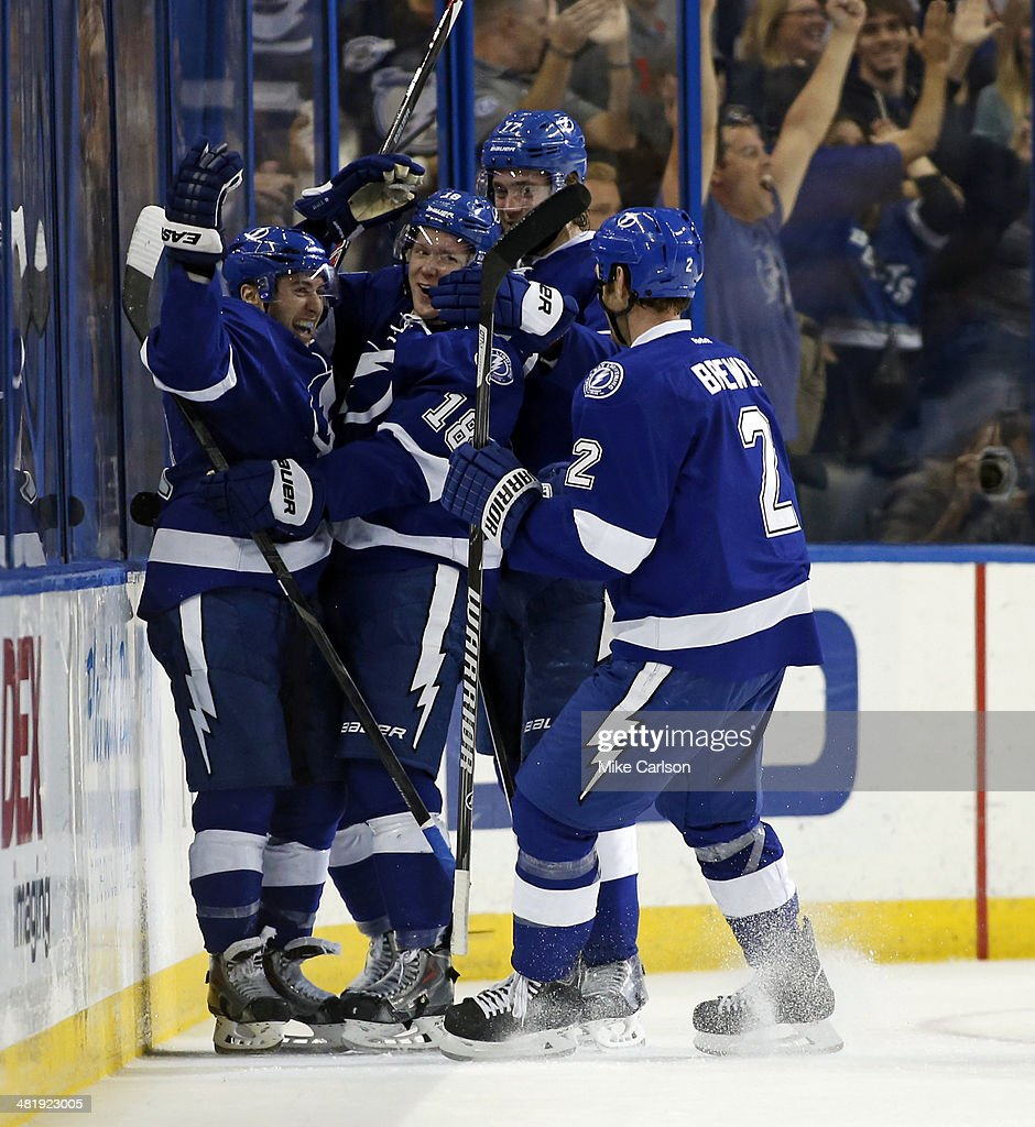 Tyler Johnson #9 of the Tampa Bay Lightning (L) celebrates his goal with teammates Ondrej Palat #18, Victor Hedman #77 and Eric Brewer #2 against the Montreal Canadiens at the Tampa Bay Times Forum on April 1, 2014 in Tampa, Florida.