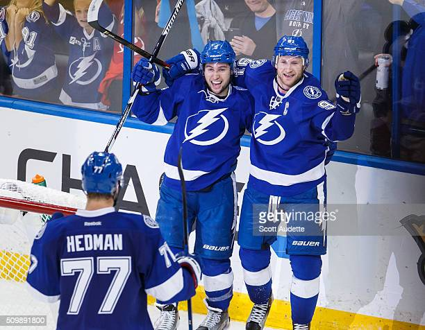 Tyler Johnson of the Tampa Bay Lightning celebrates his goal with teammates Steven Stamkos and Victor Hedman against the Nashville Predators during...