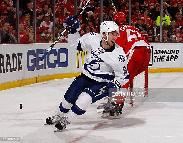 Tyler Johnson of the Tampa Bay Lightning celebrates his second period goal in front of Danny DeKeyser of the Detroit Red Wings during Game Six of the...