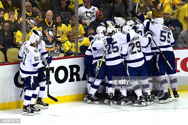Tyler Johnson of the Tampa Bay Lightning celebrates his teammates after scoring the game winning goal in overtime against MarcAndre Fleury of the...