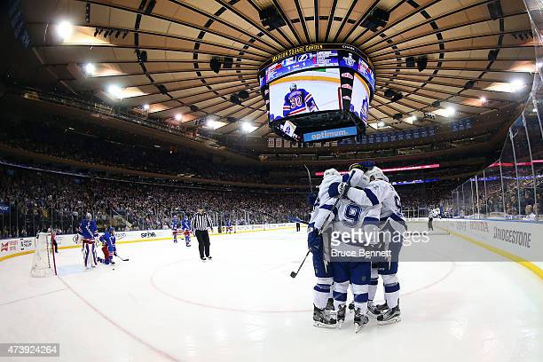 Tyler Johnson of the Tampa Bay Lightning celebrates with his teammates after his second goal in the first period against Henrik Lundqvist of the New...