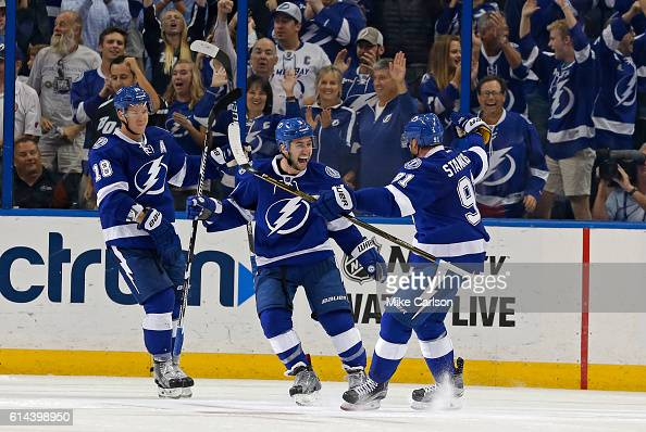 Tyler Johnson of the Tampa Bay Lightning center celebrates a goal against Detroit Red Wings with Ondrej Palat and Steven Stamkos during the third...