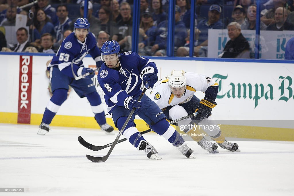 <a gi-track='captionPersonalityLinkClicked' href=/galleries/search?phrase=Tyler+Johnson+-+Ice+Hockey+Player&family=editorial&specificpeople=14574766 ng-click='$event.stopPropagation()'>Tyler Johnson</a> #9 of the Tampa Bay Lightning controls the puck against <a gi-track='captionPersonalityLinkClicked' href=/galleries/search?phrase=Taylor+Beck&family=editorial&specificpeople=4779404 ng-click='$event.stopPropagation()'>Taylor Beck</a> #41 of the Nashville Predators during the first period at Tampa Bay Times Forum on September 19, 2013 in Tampa, Florida.