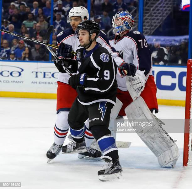 Tyler Johnson of the Tampa Bay Lightning is defended by Seth Jones of the Columbus Blue Jackets in front of Joonas Korpisalo at the Amalie Arena on...