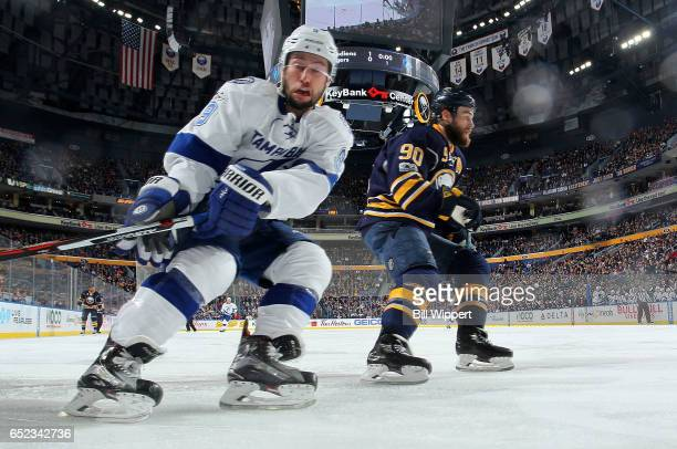 Tyler Johnson of the Tampa Bay Lightning skates against Ryan O'Reilly of the Buffalo Sabres during an NHL game at the KeyBank Center on March 4 2017...
