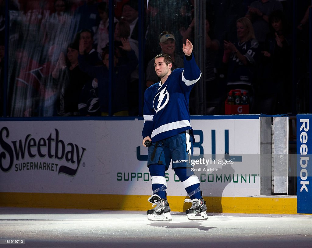 <a gi-track='captionPersonalityLinkClicked' href=/galleries/search?phrase=Tyler+Johnson+-+Ice+Hockey+Player&family=editorial&specificpeople=14574766 ng-click='$event.stopPropagation()'>Tyler Johnson</a> #9 of the Tampa Bay Lightning thanks fans for their support during the game against the Montreal Canadiens at the Tampa Bay Times Forum on April 1, 2014 in Tampa, Florida.