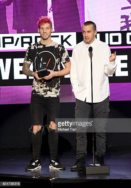Tyler Joseph and Josh Dun of Twenty One Pilots accept the award for Favorite Duo or Group Pop/Rock onstage during the 2016 American Music Awards held...