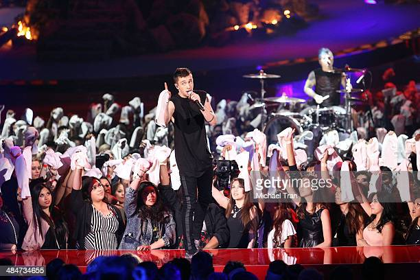 Tyler Joseph and Josh Dun of Twenty One Pilots perform onstage during the 2014 MTV Movie Awards held at Nokia Theatre LA Live on April 13 2014 in Los...