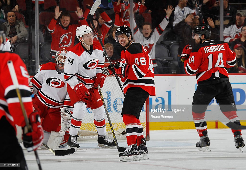 Tyler Kennedy #48 of the New Jersey Devils (l) celebrates a goal by Adam Henrique #14 (r) at 10:54 of the first period against the Carolina Hurricanes at the Prudential Center on March 1, 2016 in Newark, New Jersey.