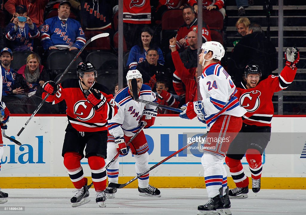 Tyler Kennedy #48 of the New Jersey Devils (l) celebrates his goal at 4:47 of the first period against the New York Rangers at the Prudential Center on February 23, 2016 in Newark, New Jersey.