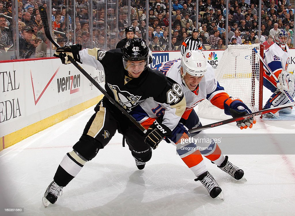 Tyler Kennedy of the Pittsburgh Penguins battles for position against Marty Reasoner of the New York Islanders on January 29 2013 at Consol Energy...