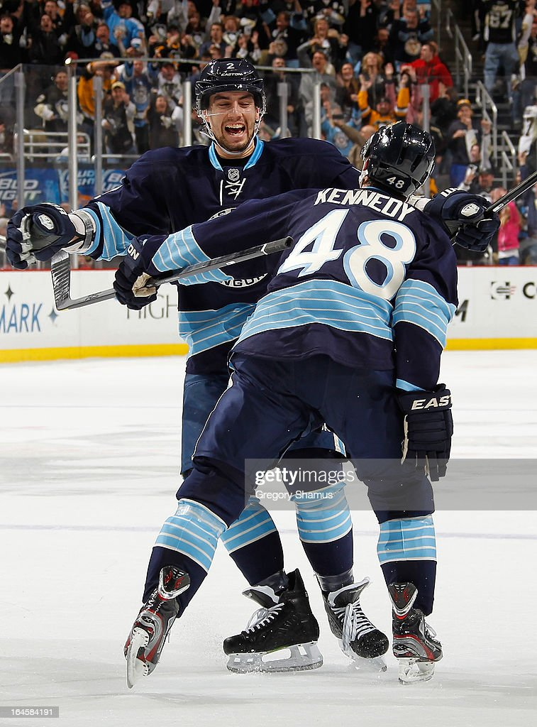 <a gi-track='captionPersonalityLinkClicked' href=/galleries/search?phrase=Tyler+Kennedy&family=editorial&specificpeople=2119414 ng-click='$event.stopPropagation()'>Tyler Kennedy</a> #48 of the Pittsburgh Penguins celebrates his game winning overtime goal with <a gi-track='captionPersonalityLinkClicked' href=/galleries/search?phrase=Matt+Niskanen&family=editorial&specificpeople=2106633 ng-click='$event.stopPropagation()'>Matt Niskanen</a> #2 against the Philadelphia Flyers on March 24, 2013 at Consol Energy Center in Pittsburgh, Pennsylvania.