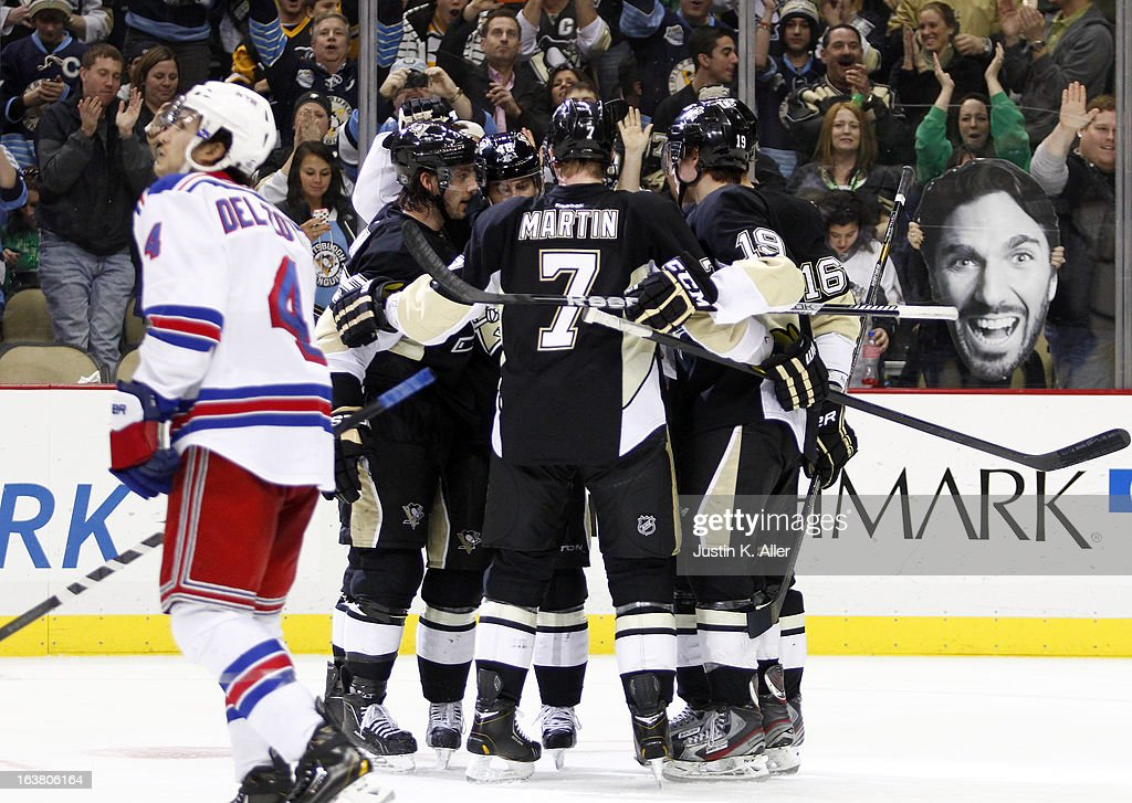 <a gi-track='captionPersonalityLinkClicked' href=/galleries/search?phrase=Tyler+Kennedy&family=editorial&specificpeople=2119414 ng-click='$event.stopPropagation()'>Tyler Kennedy</a> #48 of the Pittsburgh Penguins celebrates with teammates after scoring in the third period against the New York Rangers during the game at Consol Energy Center on March 16, 2013 in Pittsburgh, Pennsylvania. The Penguins defeated the Rangers 3-0.