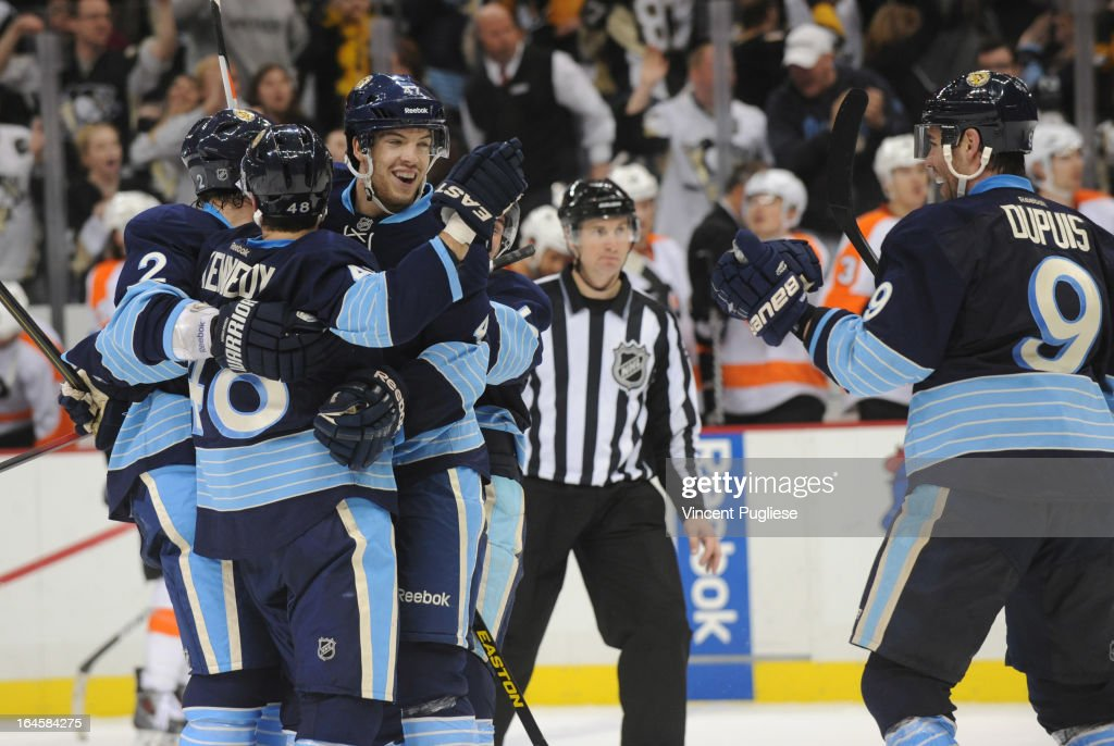 <a gi-track='captionPersonalityLinkClicked' href=/galleries/search?phrase=Tyler+Kennedy&family=editorial&specificpeople=2119414 ng-click='$event.stopPropagation()'>Tyler Kennedy</a> #48 of the Pittsburgh Penguins celebrates with teammates after scoring the winning goal in overtime to defeat the Philadelphia Flyers 2-1 on March 24, 2013 at the CONSOL Energy Center in Pittsburgh, Pennsylvania.