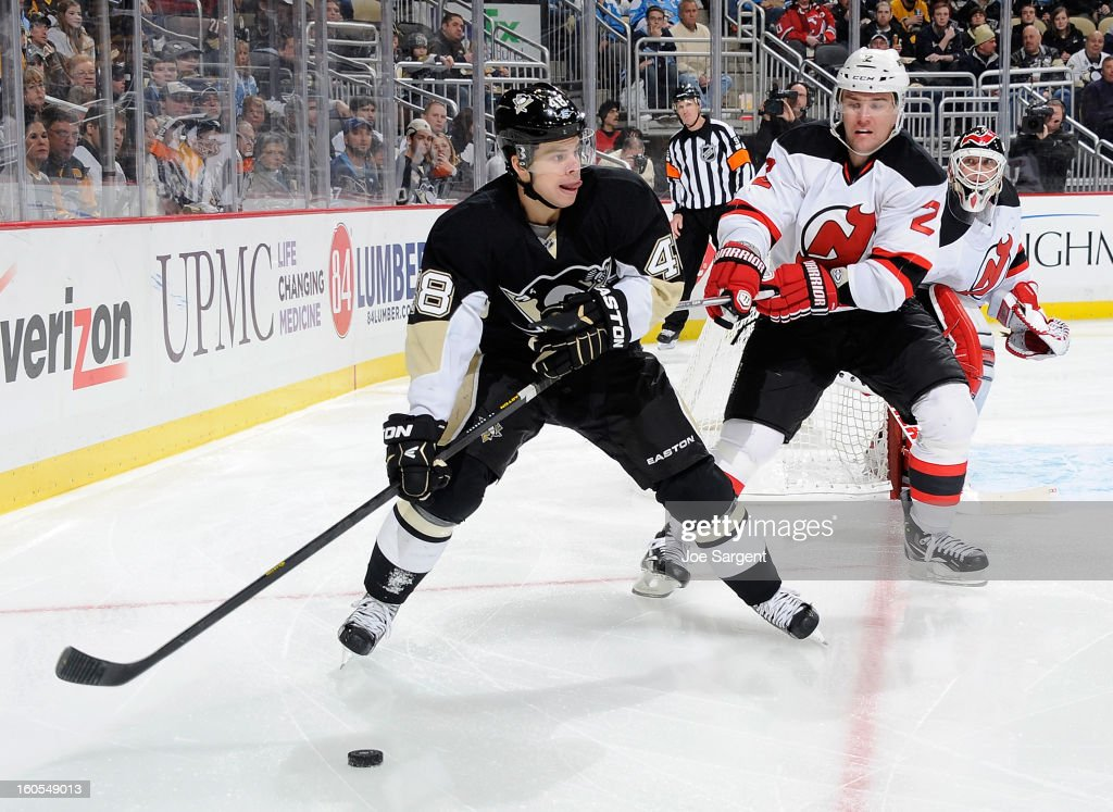 <a gi-track='captionPersonalityLinkClicked' href=/galleries/search?phrase=Tyler+Kennedy&family=editorial&specificpeople=2119414 ng-click='$event.stopPropagation()'>Tyler Kennedy</a> #48 of the Pittsburgh Penguins looks to pass in front of the defense of <a gi-track='captionPersonalityLinkClicked' href=/galleries/search?phrase=Marek+Zidlicky&family=editorial&specificpeople=203291 ng-click='$event.stopPropagation()'>Marek Zidlicky</a> #2 of the New Jersey Devils on February 2, 2013 at Consol Energy Center in Pittsburgh, Pennsylvania.