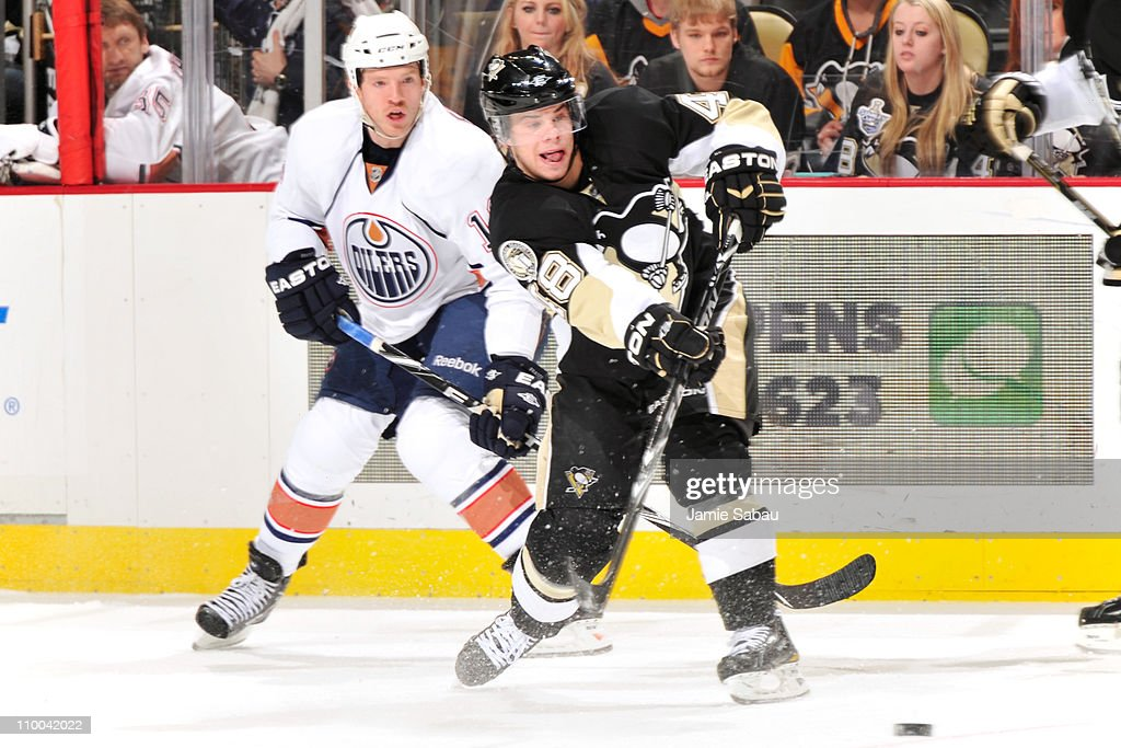 Tyler Kennedy #48 of the Pittsburgh Penguins makes a pass in front of Colin Fraser #16 of the Edmonton Oilers on March 13, 2011 at CONSOL Energy Center in Pittsburgh, Pennsylvania. Kennedy had three assists in Pittsurgh's 5-1 win over Edmonton.