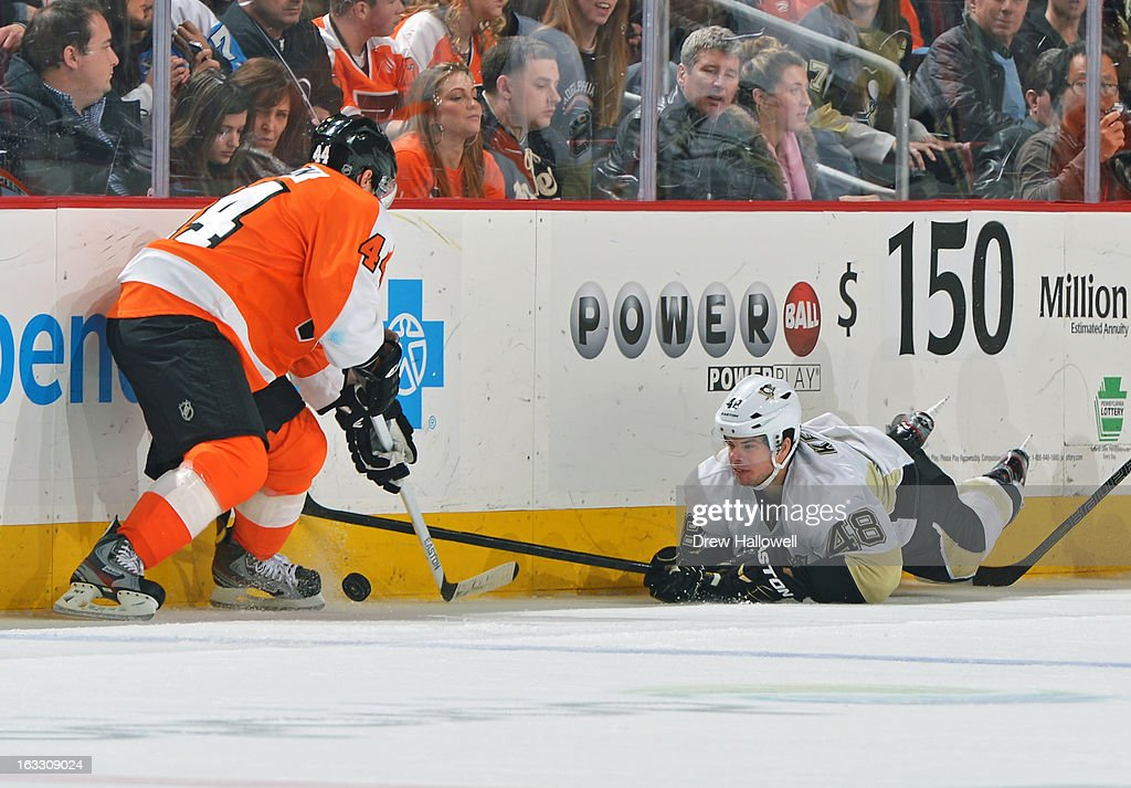 Tyler Kennedy #48 of the Pittsburgh Penguins tries to knock the puck away from Kimmo Timonen #44 of the Philadelphia Flyers at the Wells Fargo Center on March 7, 2013 in Philadelphia, Pennsylvania. The Penguins won 5-4.