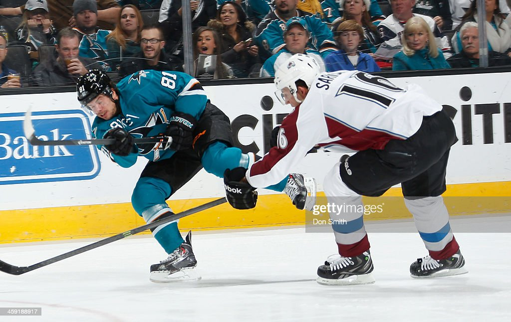 Tyler Kennedy #81 of the San Jose Sharks gets a shot off against Cory Sarich #16 of the Colorado Avalanche during an NHL game on December 23, 2013 at SAP Center in San Jose, California.