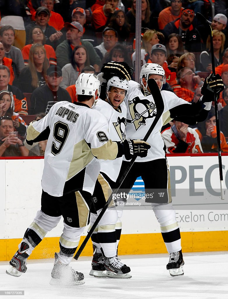 Tyler Kennedy #48, Pascal Dupuis #9 and Paul Martin #7 of the Pittsburgh Penguins celebrate Kennedy's goal against the Philadelphia Flyers at Wells Fargo Center on January 19, 2013 in Philadelphia, Pennsylvania.