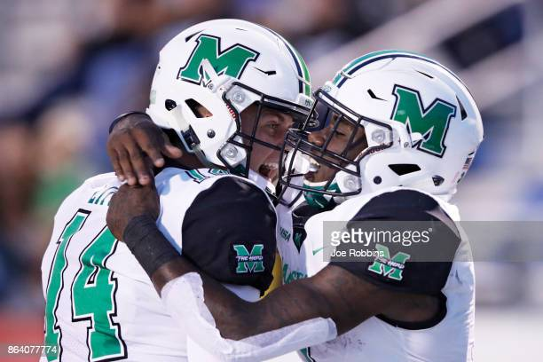 Tyler King of the Marshall Thundering Herd celebrates with Chase Litton after rushing for a 15yard touchdown in the first quarter of a game against...