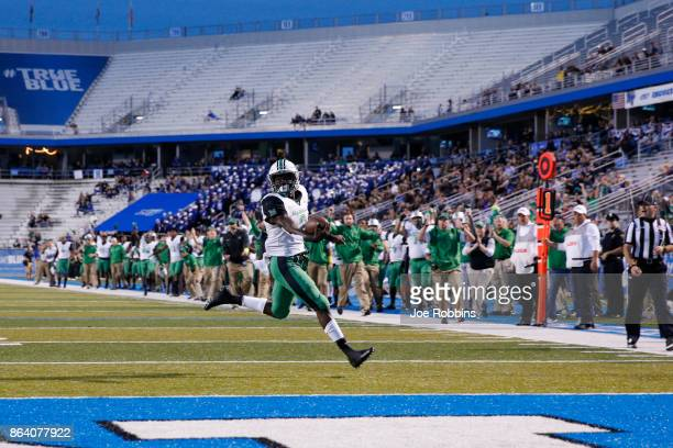 Tyler King of the Marshall Thundering Herd runs for a 15yard touchdown in the first quarter of a game against the Middle Tennessee Blue Raiders at...