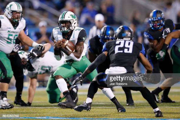 Tyler King of the Marshall Thundering Herd runs the ball in the first quarter of a game against the Middle Tennessee Blue Raiders at Floyd Stadium on...