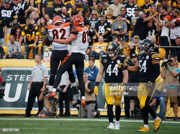 Tyler Kroft of the Cincinnati Bengals celebrates with Cethan Carter after a 1 yard touchdown reception in the second quarter during the game against...