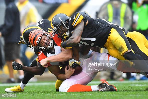 Tyler Kroft of the Cincinnati Bengals is brought down by Robert Golden of the Pittsburgh Steelers in the first quarter during the game at Heinz Field...