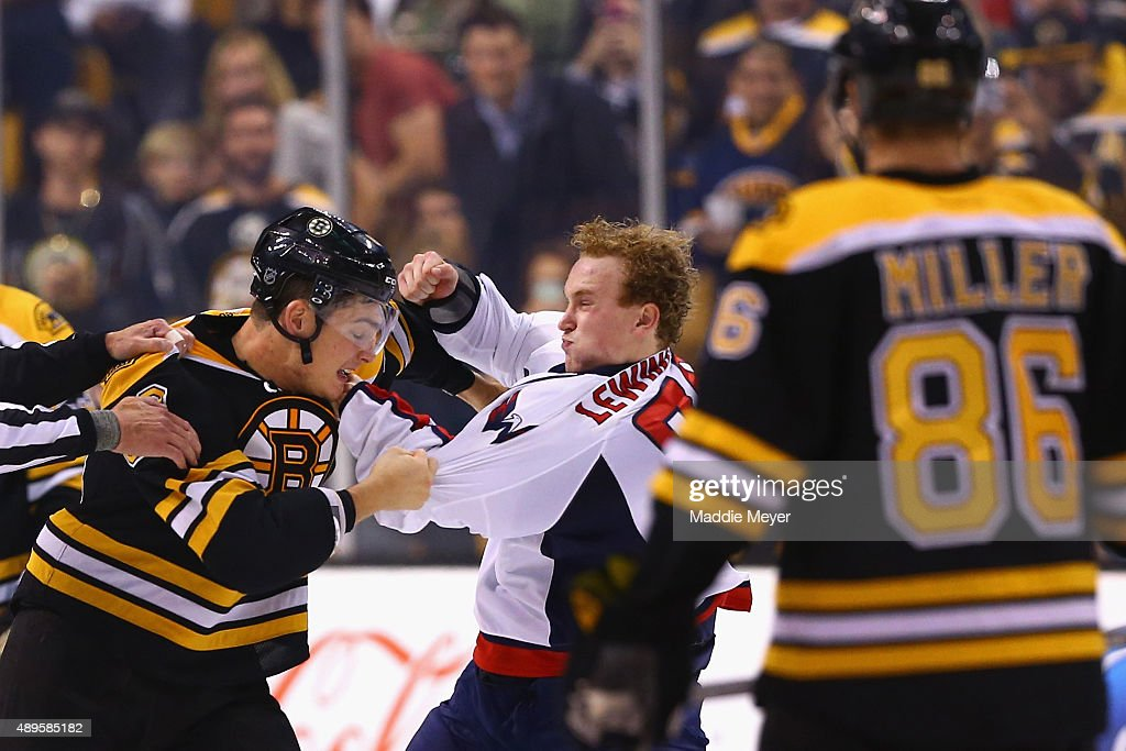 Tyler Lewington #78 of the Washington Capitals and Justin Hickman #60 of the Boston Bruins fight during the second period at TD Garden on September 22, 2015 in Boston, Massachusetts.