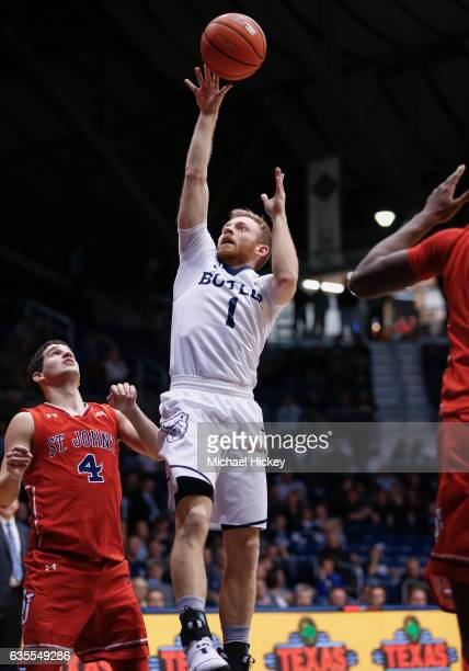 Tyler Lewis of the Butler Bulldogs shoots the ball against Federico Mussini of the St John's Red Storm at Hinkle Fieldhouse on February 15 2017 in...