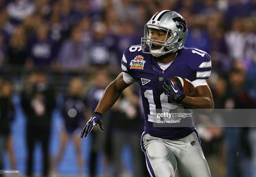 Tyler Lockett #16 of the Kansas State Wildcats carries the ball against the Oregon Ducks during the Tostitos Fiesta Bowl at University of Phoenix Stadium on January 3, 2013 in Glendale, Arizona.